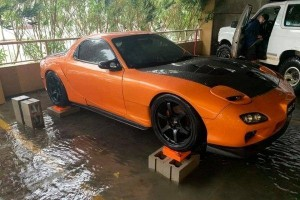 Man saves total stranger's Mazda RX-7 from getting swept away in a flood