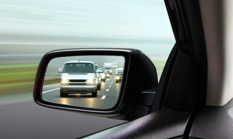 Adjusting the mirrors further out would eliminate as much blind spots as possble
