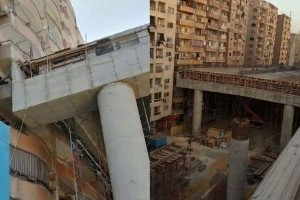 This construction of a highway in Egypt is only 50 cm away from residential buildings