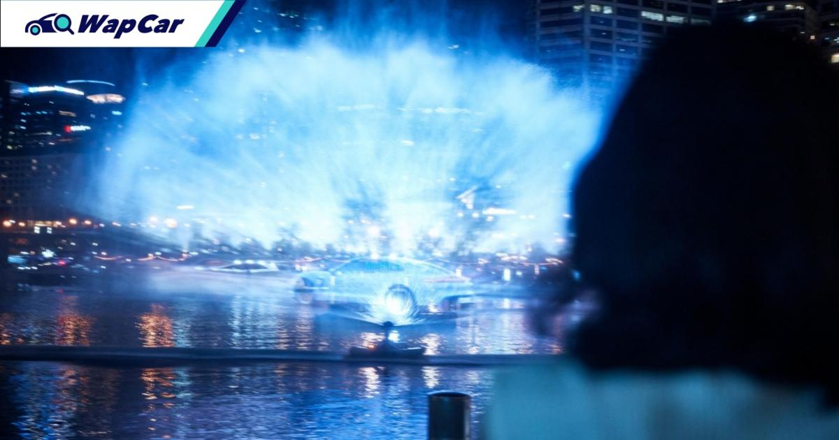 Porsche Taycan mixes water with electricity at Sydney's Darling Harbor 01