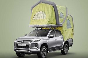 The tent on this Mitsubishi Triton camper literally blows