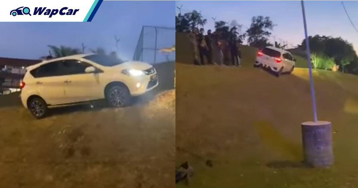 Another day, another flying Perodua Myvi spotted; Jumps divider and landed on steep slope 01